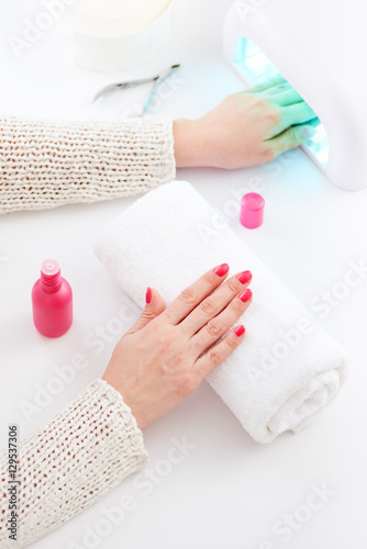 Fotobehang Manicure Manicure and hybrid nails painting process.