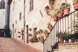 Staircase street of the old town of Assisi with ancient stone h