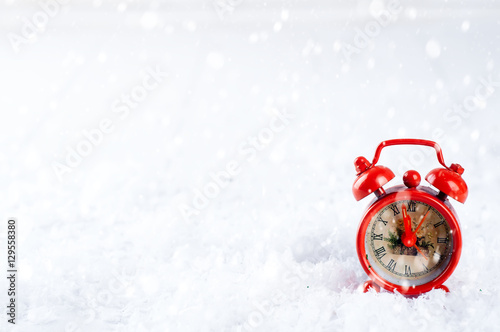 vintage alarm clock in the snow Poster