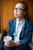 Female doctor having tea in clinic