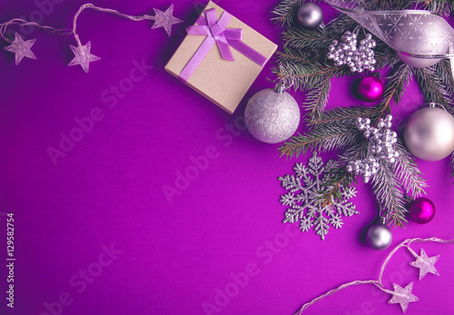 Purple Christmas background with a present Poster
