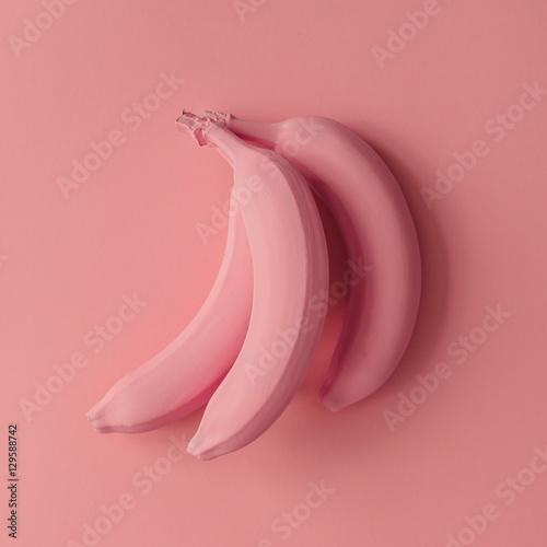Pink bananas on pink background. Minimal style. Flat lay. - 129588742