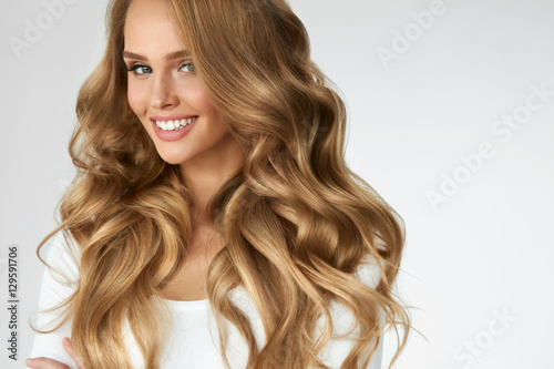 Poster Beautiful Curly Hair. Girl With Wavy Long Hair Portrait. Volume