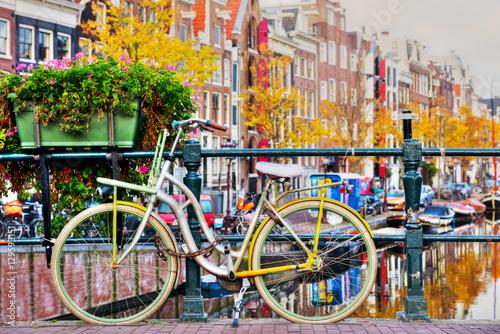 Papiers peints Amsterdam Bycicle parked at the bridge