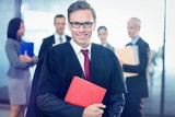 Portrait of lawyer holding law book - 129600584