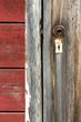 Broken door handle and old lock on ghost town in Kennicott, Alas