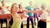 Men and ladies dancing zumba