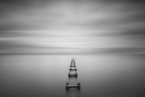 Long Exposure Seascape of some old pilings  - 129624331