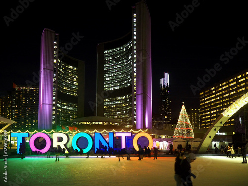 Poster TORONTO  City Hall skating ring and its colorful lights are a popular winter att