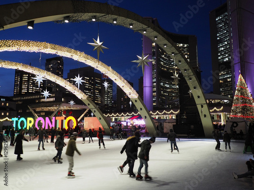 Fotobehang Toronto TORONTO - City Hall skating ring and its colorful lights are a popular winter attraction