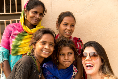 Tourist taking photos with cute Indian girls