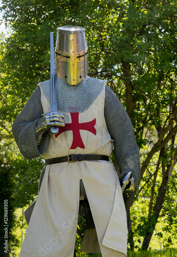 A person dresses up historically to mimic a knights templar in full armour Poster