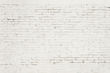 Fototapety Old brick wall with white paint background texture