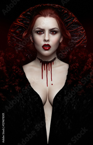 Sexy woman vampire in black dress with blood on neck Poster