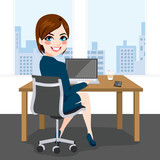 Beautiful brunette successful businesswoman back view sitting working with laptop at office