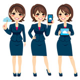 Beautiful young brunette businesswoman using different cloud devices