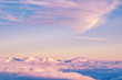 Abstract background with pink, purple and blue colors clouds. Sunset sky above the clouds. Dreamy fantasy background in soft pastel colors .