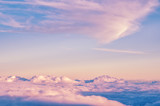 Abstract background with pink, purple and blue colors clouds. Sunset sky above the clouds. Dreamy fantasy background in soft pastel colors . - 129719122