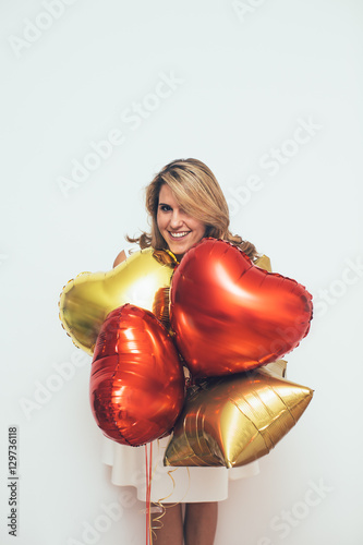 Poster Woman with balloons in front of white wall