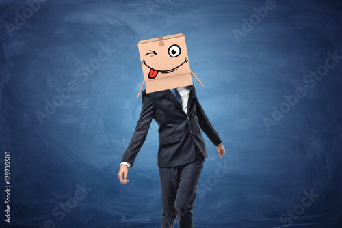Businessman wearing cardboard box with drawn winking face on his head Poster