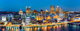 Pittsburgh downtown panorama at dusk viewed from Grandview Overlook across Monongahela River - 129740713