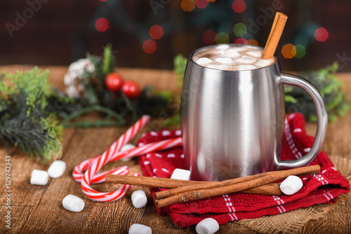 Tuinposter Chocolade Hot chocolate in silver stainless steel cup with Christmas decor