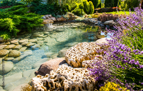 beautiful landscaping with beautiful plants and flowers - 129757199