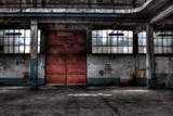 The red door of a garage for mine vehicles