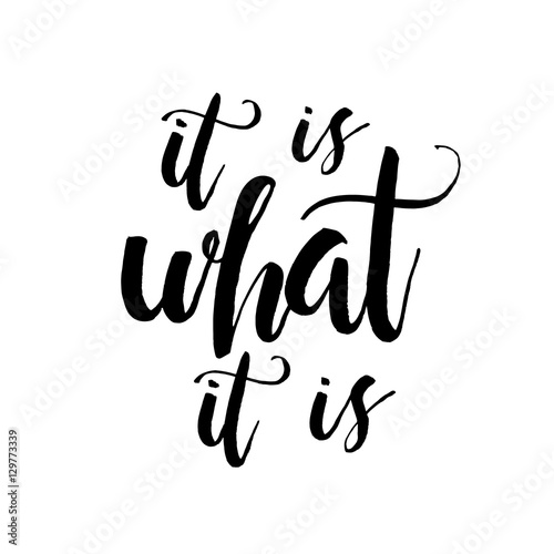 Fototapeta It Is What It Is - Inspirational wisdom quote handwritten with black ink and brush. Good for posters, t-shirts, prints, cards, banners. Hand lettering, typographic element for your design.