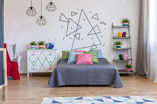 Bright bedroom with commode and bed Poster