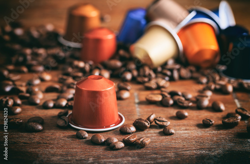 Poster Colorful espresso capsules on wooden background
