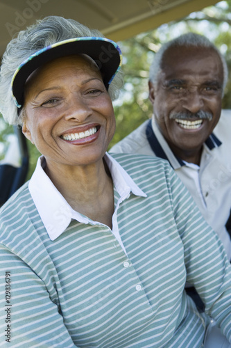 Closeup portrait of happy senior couple in golf course smiling Poster