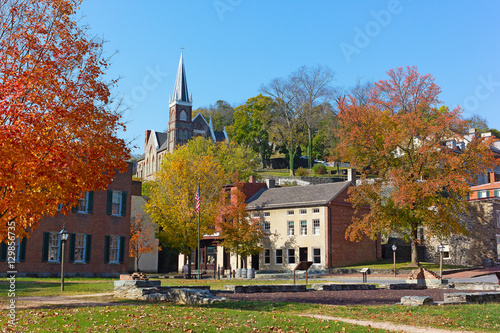 Harpers Ferry historic town in autumn, West Virginia, USA. St. Peter's Catholic Church and historic town buildings.