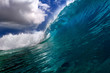 Bright clear blue ocean wave for surfing lessons