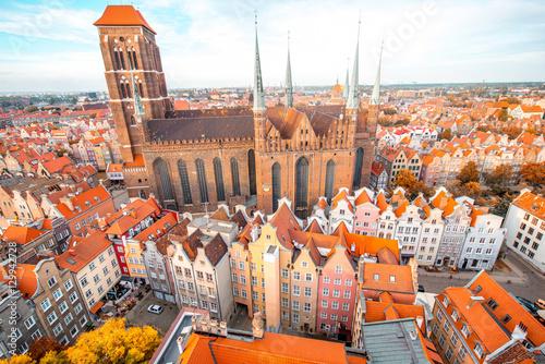 Zdjęcia na płótnie, fototapety na wymiar, obrazy na ścianę : Cityscape aerial view on the old town with saint Marys church in Gdansk, Poland