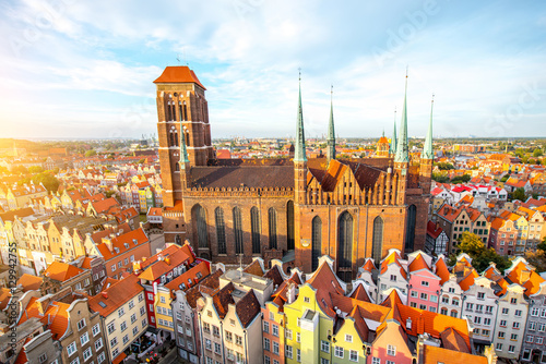 Cityscape aerial view on the old town with saint Marys church on the sunset in Gdansk, Poland - 129942755