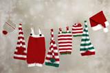 Christmas handmade baby pants and hats hanging on a clothesline - 129968336