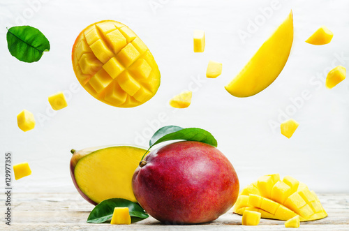 mango with flying slices - 129977355