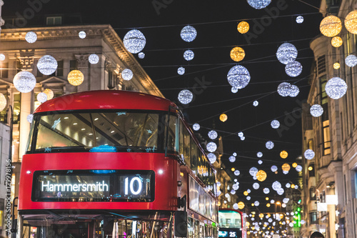 Foto op Canvas Londen Red double decker bus in London during Christmas time