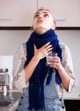 woman in scarf gargling throat with domestic soda