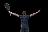 Tennis player with hands up isolated on black