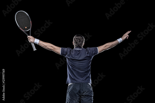 Fotobehang Tennis Tennis player with hands up isolated on black