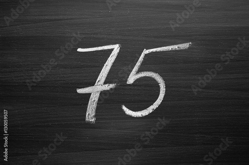 number seventy five enumeration written with a chalk on the blackboard Poster