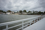 Coastal houses of City Island from white wooden pier - 130096198