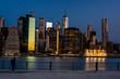 New York skyline at night with photographer