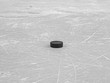 Hockey puck on ice hockey rink, selective focus