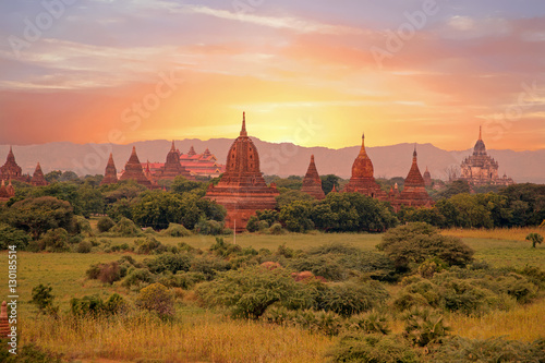 Poster Ancient pagodas in the countryside from Bagan in Myanmar at suns