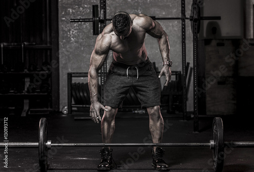 Muscle Man about to Pickup Barbell
