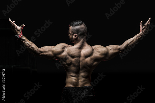 Man showing muscular Back Poster