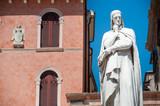 Landmarks of Verona: the statue of the famous italian poet Dante alighieri in Lords Square - 130237536